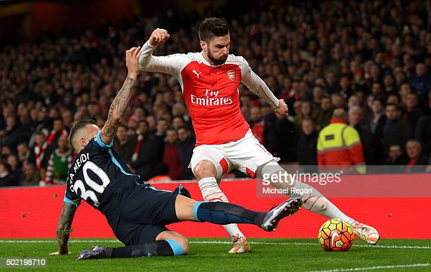 Olivier Giroud of Arsenal is tackled by Nicolas Otamendi of Manchester City during the Barclays Premier League match between Arsenal and Manchester...