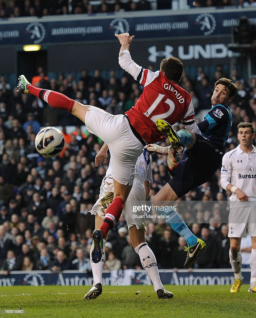Olivier Giroud of Arsenal jumps with Tottenham goalkeeper Hugo Lloris during the Barclays Premier League match between Tottenham Hotspur and Arsenal at White Hart Lane on March 03, 2013 in London, England.