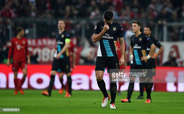 Olivier Giroud of Arsenal looks dejected during the UEFA Champions League Group F match between FC Bayern Muenchen and Arsenal FC at the Allianz...