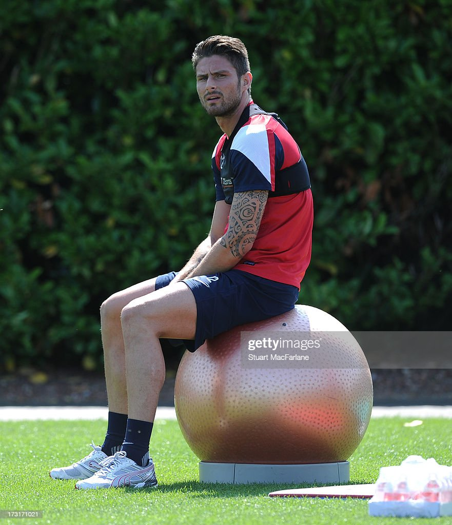 Olivier Giroud of Arsenal looks on during a training session at London Colney on July 09, 2013 in St Albans, England.