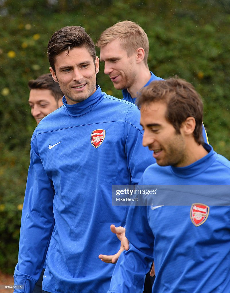 <a gi-track='captionPersonalityLinkClicked' href=/galleries/search?phrase=Olivier+Giroud&family=editorial&specificpeople=5678034 ng-click='$event.stopPropagation()'>Olivier Giroud</a> of Arsenal makes a point to team mate <a gi-track='captionPersonalityLinkClicked' href=/galleries/search?phrase=Mathieu+Flamini&family=editorial&specificpeople=242961 ng-click='$event.stopPropagation()'>Mathieu Flamini</a> of Arsenal during a wet Arsenal training session ahead of the UEFA Champions League Group F match against Borussia Dortmund at London Colney on October 21, 2013 in St Albans, England.