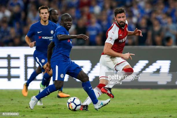 Olivier Giroud of Arsenal passes against N'Golo Kant of Chelsea during the PreSeason Friendly match between Arsenal FC and Chelsea FC at Birds Nest...