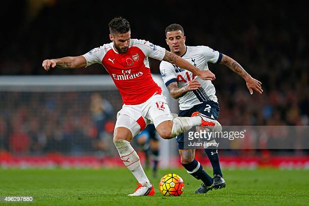 Olivier Giroud of Arsenal passes the ball as Kyle Walker of Spurs closes in during the Barclays Premier League match between Arsenal and Tottenham...