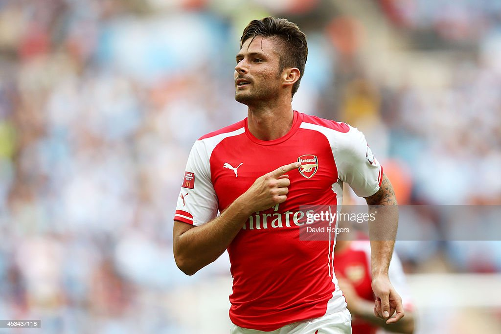 <a gi-track='captionPersonalityLinkClicked' href=/galleries/search?phrase=Olivier+Giroud&family=editorial&specificpeople=5678034 ng-click='$event.stopPropagation()'>Olivier Giroud</a> of Arsenal points to the badge on his shirt as he celebrates scoring the third goal during the FA Community Shield match between Manchester City and Arsenal at Wembley Stadium on August 10, 2014 in London, England.