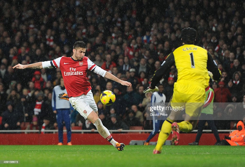 Olivier Giroud of Arsenal prepares to shoot at Petr Cech of Chelsea during the match between Arsenal and Chelsea in the Barclays Premier League at Emirates Stadium on December 23, 2013 in London, England.