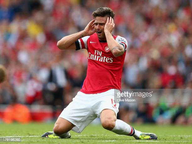 Olivier Giroud of Arsenal reacts to a missed opportunity the Barclays Premier League match between Arsenal and Tottenham Hotspur at Emirates Stadium...