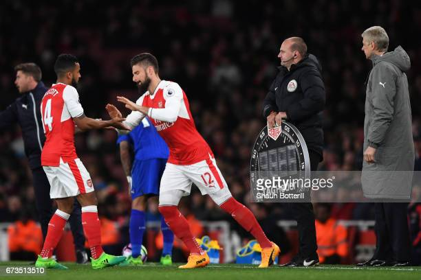 Olivier Giroud of Arsenal replaces Theo Walcott of Arsenal during the Premier League match between Arsenal and Leicester City at the Emirates Stadium...