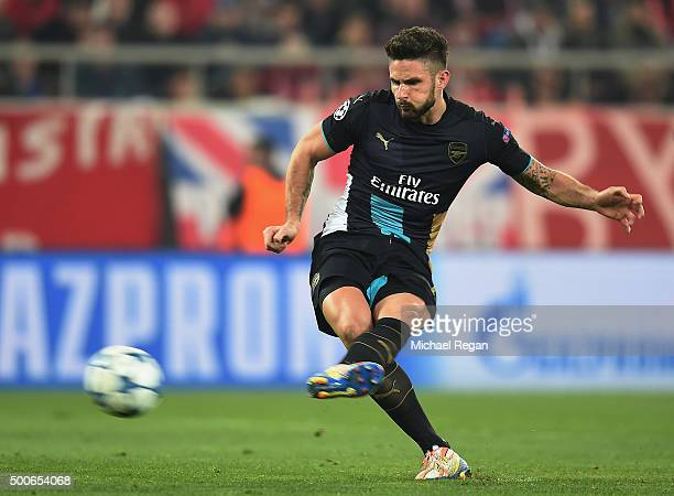 Olivier Giroud of Arsenal scores a penalty for the third goal and his hattrick for Arsenal during the UEFA Champions League Group F match between...