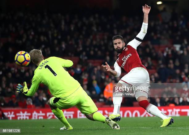 Olivier Giroud of Arsenal scores his sides fifth goal past Jonas Lossl of Huddersfield Town during the Premier League match between Arsenal and...