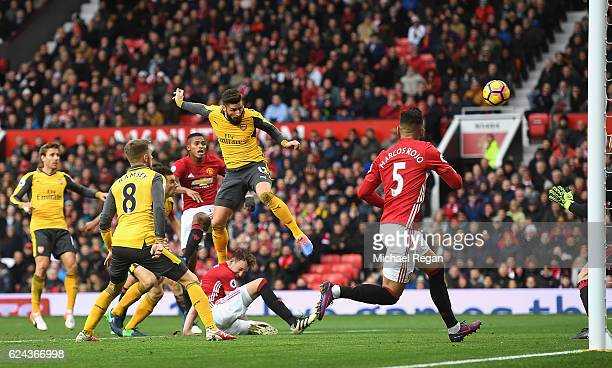 Olivier Giroud of Arsenal scores his sides first goal during the Premier League match between Manchester United and Arsenal at Old Trafford on...