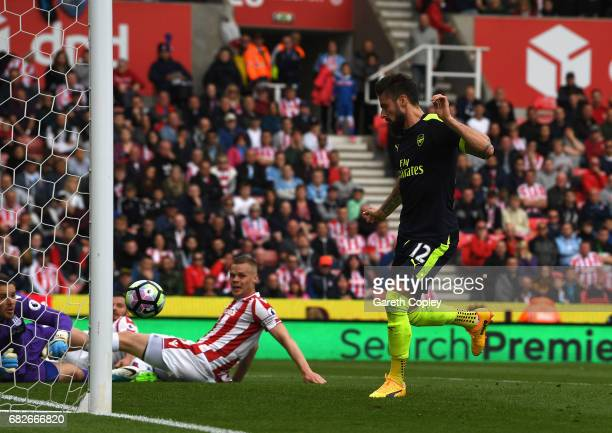 Olivier Giroud of Arsenal scores his sides first goal during the Premier League match between Stoke City and Arsenal at Bet365 Stadium on May 13 2017...