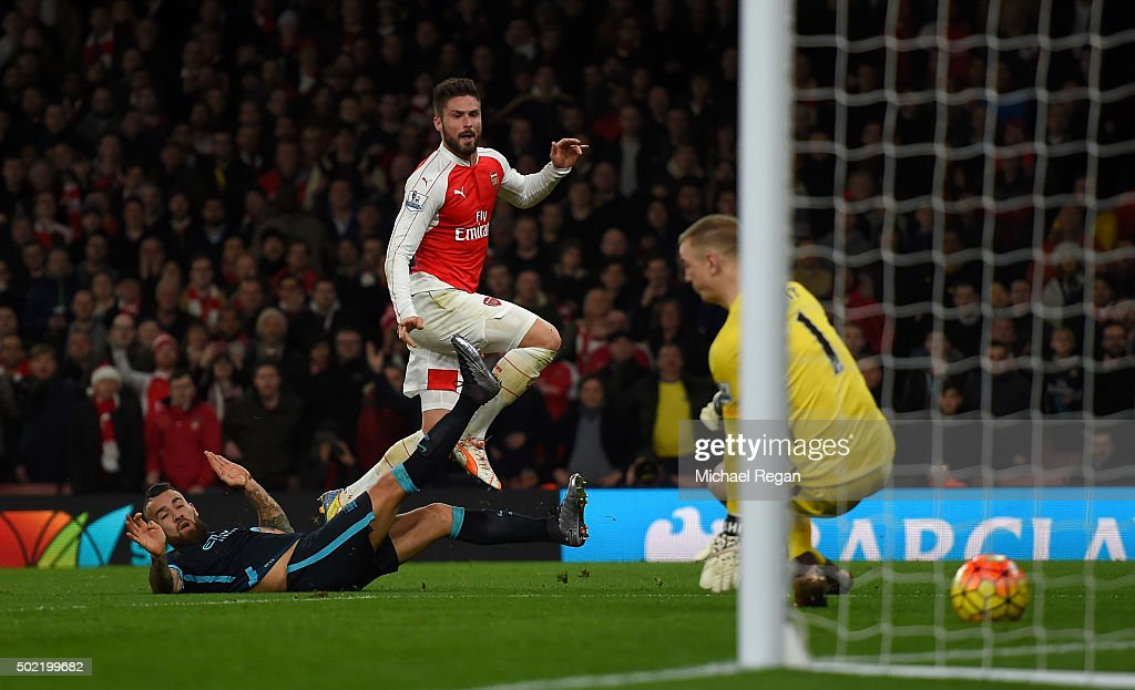 Olivier Giroud of Arsenal scores his side's second goal past Joe Hart of Manchester City during the Barclays Premier League match between Arsenal and Manchester City at Emirates Stadium on December 21, 2015 in London, England.