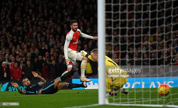 Olivier Giroud of Arsenal scores his side's second goal past Joe Hart of Manchester City during the Barclays Premier League match between Arsenal and...