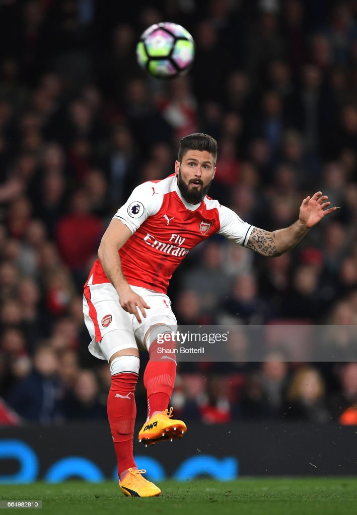 Olivier Giroud of Arsenal scores his sides third goal during the Premier League match between Arsenal and West Ham United at the Emirates Stadium on April 5, 2017 in London, England.