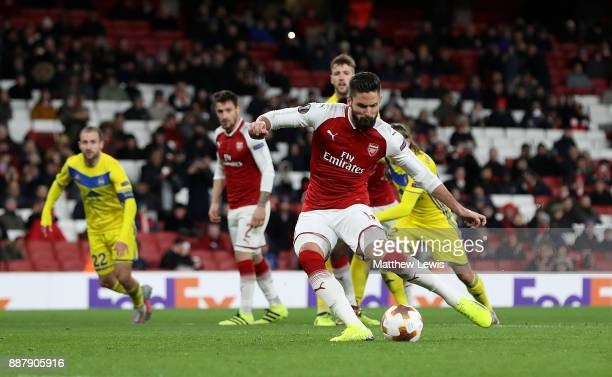 Olivier Giroud of Arsenal scores his teams fifth goal of the game from the penalty spot during the UEFA Europa League group H match between Arsenal...