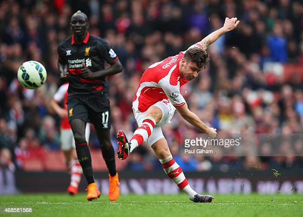 Olivier Giroud of Arsenal scores his team's fourth goal during the Barclays Premier League match between Arsenal and Liverpool at Emirates Stadium on...