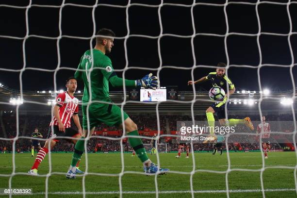 Olivier Giroud of Arsenal scores his team's second goal during the Premier League match between Southampton and Arsenal at St Mary's Stadium on May...