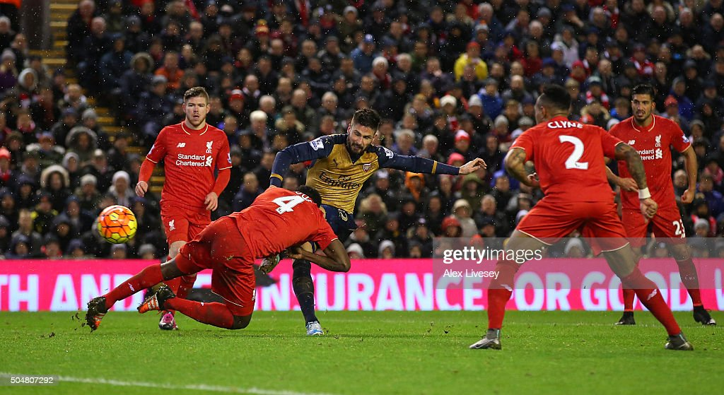 Olivier Giroud (C) of Arsenal scores his team's third goal during the Barclays Premier League match between Liverpool and Arsenal at Anfield on January 13, 2016 in Liverpool, England.