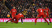 Olivier Giroud of Arsenal scores his team's third goal during the Barclays Premier League match between Liverpool and Arsenal at Anfield on January...