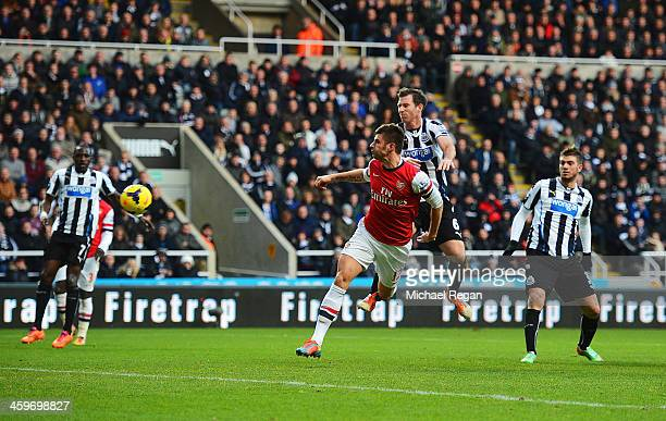 Olivier Giroud of Arsenal scores the opening goal during the Barclays Premier League match between Newcastle United and Arsenal at St James' Park on...