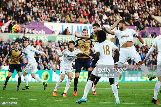 Olivier Giroud of Arsenal scores the opening goal during the Barclays Premier League match between Swansea City and Arsenal at Liberty Stadium on...