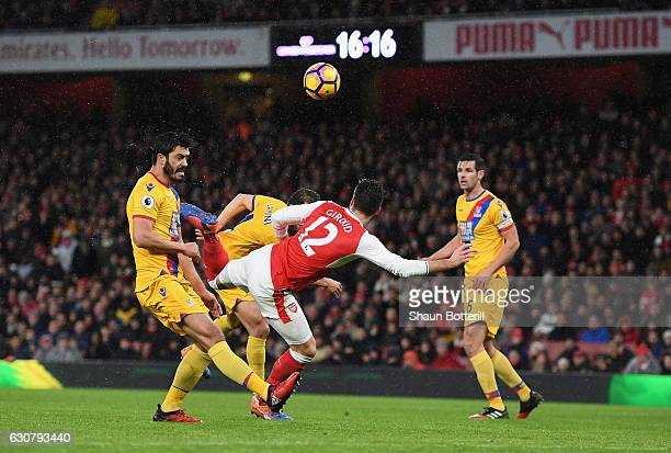 Olivier Giroud of Arsenal scores the opening goal during the Premier League match between Arsenal and Crystal Palace at Emirates Stadium on January 1...