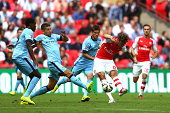 Olivier Giroud of Arsenal scores the third goal during the FA Community Shield match between Manchester City and Arsenal at Wembley Stadium on August...