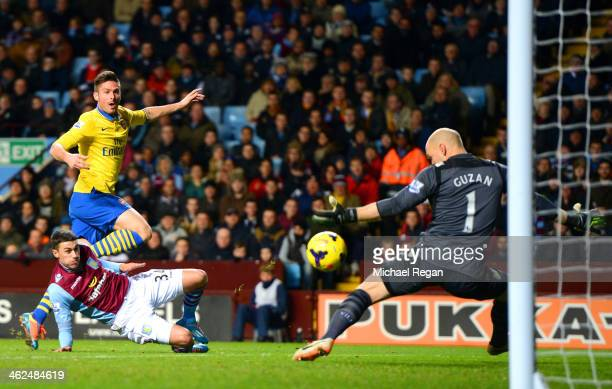 Olivier Giroud of Arsenal scores their second goal past Brad Guzan of Aston Villa during the Barclays Premier League match between Aston Villa and...