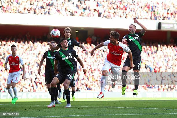 Olivier Giroud of Arsenal scores with a header during the Barclays Premier League match between Arsenal and Stoke City at the Emirates Stadium on...