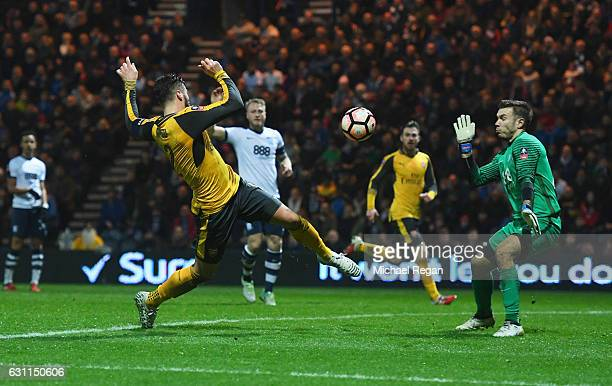 Olivier Giroud of Arsenal shoots past Chris Maxwell of Preston North End but the goal is disallowed during the Emirates FA Cup Third Round match...