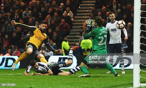 Olivier Giroud of Arsenal shoots past Chris Maxwell of Preston North End to score their second goal during the Emirates FA Cup Third Round match...