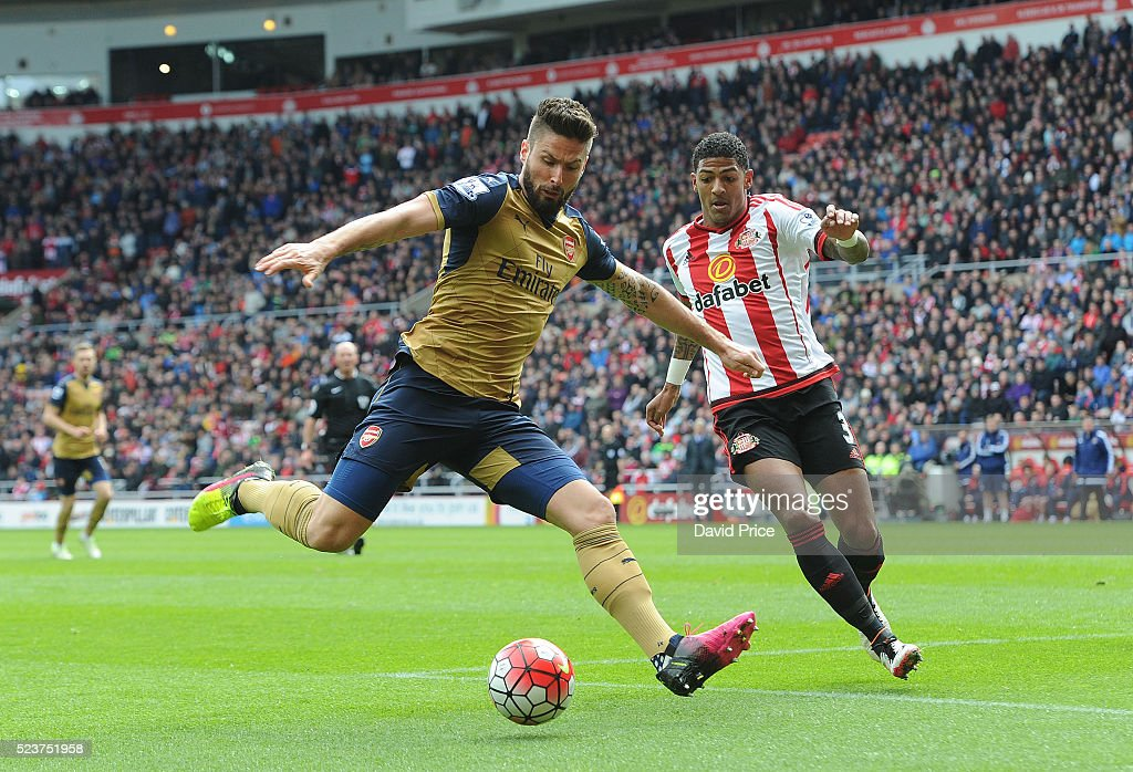 Olivier Giroud of Arsenal shoots under pressure from Patrick van Aanholt of Sunderland during the Barclays Premier League match between Sunderland...