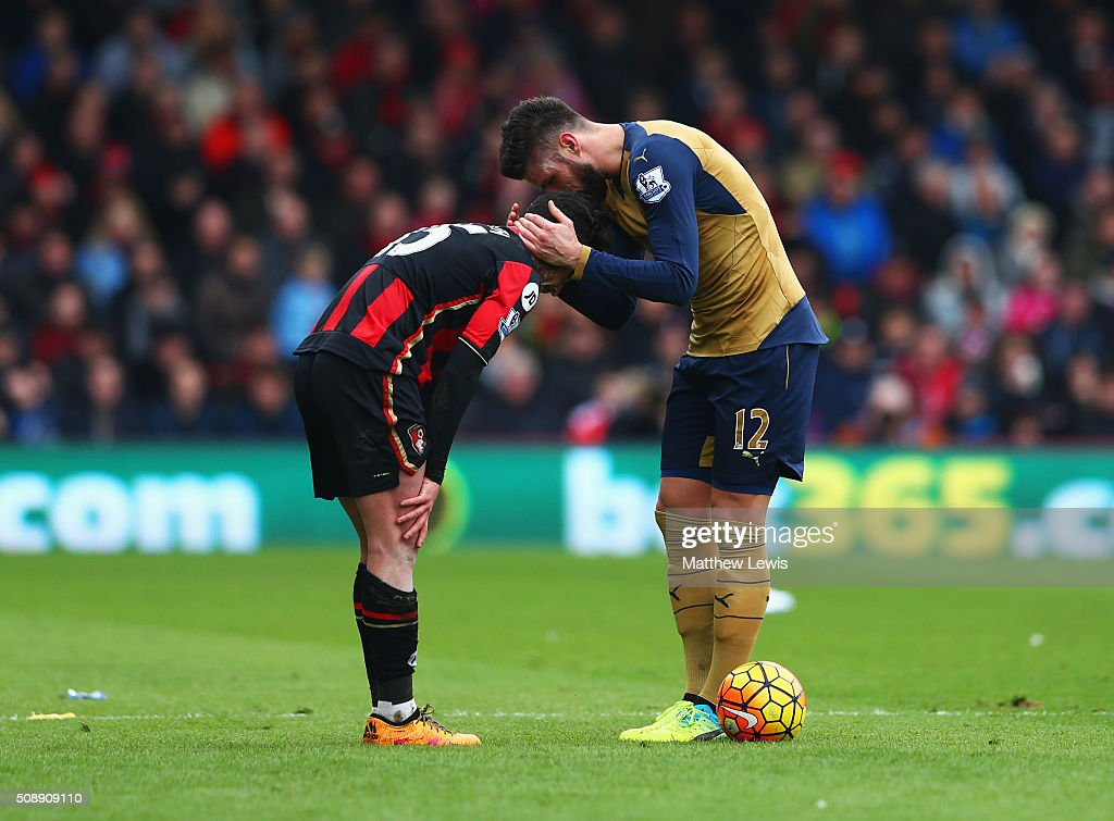 <a gi-track='captionPersonalityLinkClicked' href=/galleries/search?phrase=Olivier+Giroud&family=editorial&specificpeople=5678034 ng-click='$event.stopPropagation()'>Olivier Giroud</a> of Arsenal speaks to <a gi-track='captionPersonalityLinkClicked' href=/galleries/search?phrase=Adam+Smith+-+Rechtsachter+voetbal&family=editorial&specificpeople=14054674 ng-click='$event.stopPropagation()'>Adam Smith</a> of Bournemouth as he commits a foul during the Barclays Premier League match between A.F.C. Bournemouth and Arsenal at the Vitality Stadium on February 7, 2016 in Bournemouth, England.
