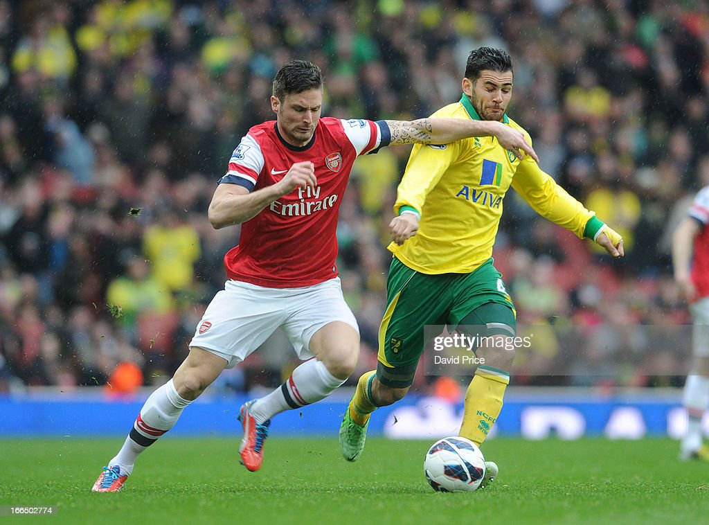 <a gi-track='captionPersonalityLinkClicked' href=/galleries/search?phrase=Olivier+Giroud&family=editorial&specificpeople=5678034 ng-click='$event.stopPropagation()'>Olivier Giroud</a> of Arsenal takes on Bradley Johnson of Norwich during the Barclays Premier League match between Arsenal and Norwich City at Emirates Stadium on April 13, 2013 in London, England.