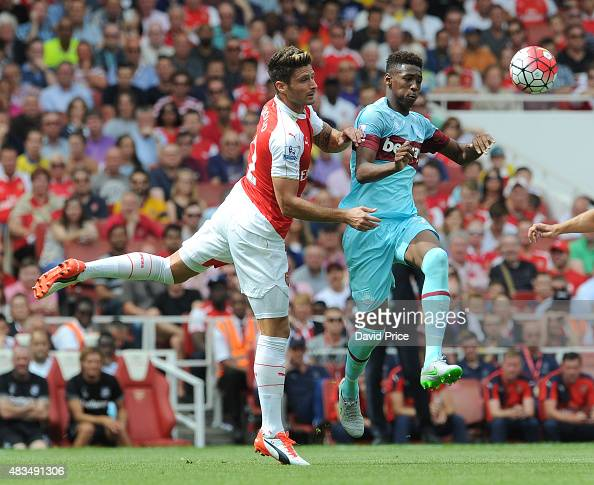 Olivier Giroud of Arsenal under pressure from Reece Oxford of West Ham during the Barclays Premier League match between Arsenal and West Ham United at