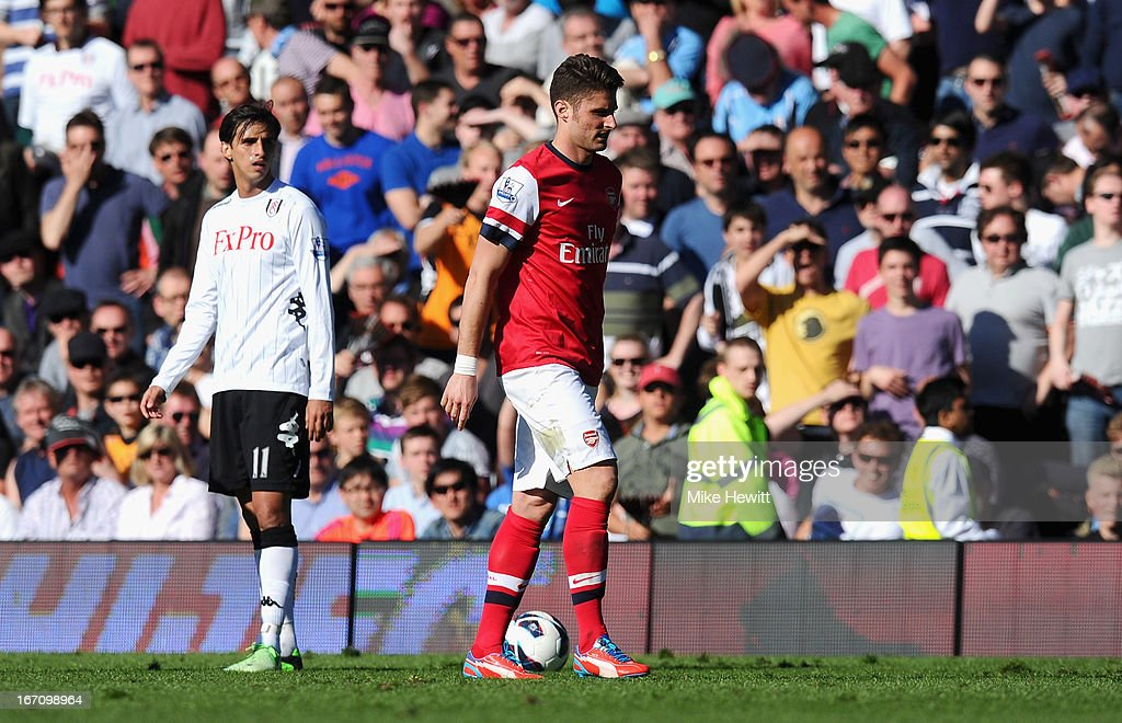 <a gi-track='captionPersonalityLinkClicked' href=/galleries/search?phrase=Olivier+Giroud&family=editorial&specificpeople=5678034 ng-click='$event.stopPropagation()'>Olivier Giroud</a> of Arsenal walks off the pitch after being shown a red card and sent off after a tackle on Stanislav Manolev of Fulham during the Barclays Premier League match between Fulham and Arsenal at Craven Cottage on April 20, 2013 in London, England.