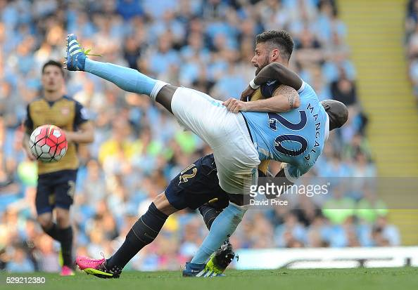 http://media.gettyimages.com/photos/olivier-giroud-of-arsenal-wrestles-with-eliaquim-mangala-of-man-city-picture-id529212380?s=594x594