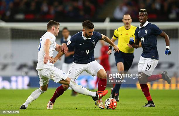 Olivier Giroud of France and Gary Cahill of England compete for the ball during the International Friendly match between England and France at...