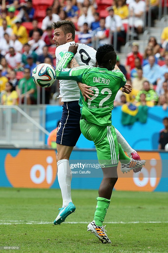 <a gi-track='captionPersonalityLinkClicked' href=/galleries/search?phrase=Olivier+Giroud&family=editorial&specificpeople=5678034 ng-click='$event.stopPropagation()'>Olivier Giroud</a> of France and <a gi-track='captionPersonalityLinkClicked' href=/galleries/search?phrase=Kenneth+Omeruo&family=editorial&specificpeople=6392838 ng-click='$event.stopPropagation()'>Kenneth Omeruo</a> of Nigeria in action during the 2014 FIFA World Cup Brazil Round of 16 match between France and Nigeria at Estadio Nacional on June 30, 2014 in Brasilia, Brazil.
