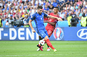 Olivier Giroud of France and Nani of Portugal during the European Championship Final between Portugal and France at Stade de France on July 10 2016...