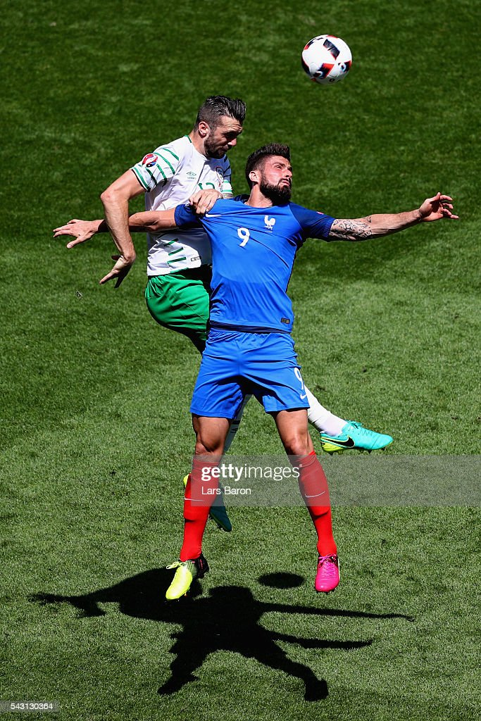 <a gi-track='captionPersonalityLinkClicked' href=/galleries/search?phrase=Olivier+Giroud&family=editorial&specificpeople=5678034 ng-click='$event.stopPropagation()'>Olivier Giroud</a> of France and <a gi-track='captionPersonalityLinkClicked' href=/galleries/search?phrase=Shane+Duffy+-+Soccer+Player&family=editorial&specificpeople=16068436 ng-click='$event.stopPropagation()'>Shane Duffy</a> of Republic of Ireland compete for the ball during the UEFA EURO 2016 round of 16 match between France and Republic of Ireland at Stade des Lumieres on June 26, 2016 in Lyon, France.