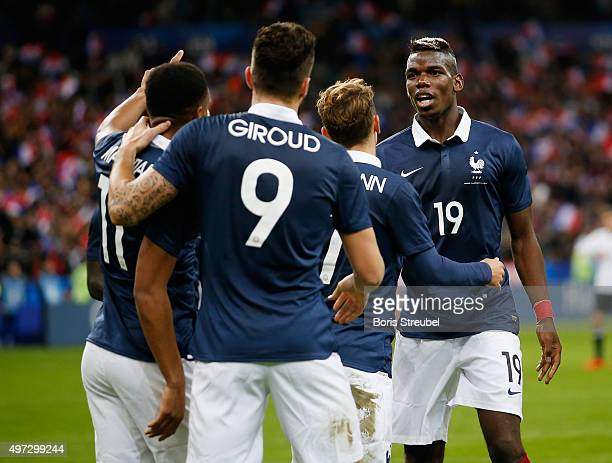 Olivier Giroud of France celebrates his team's first goal with team mates during the International Friendly match between France and Germany at the...