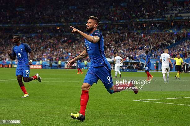 Olivier Giroud of France celebrates scoring his side's fifth goal during the UEFA Euro 2016 Quarter Final match between France and Iceland at Stade...
