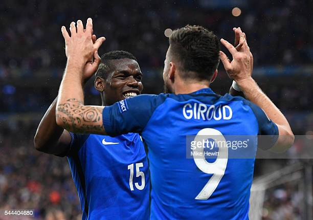 Olivier Giroud of France celebrates scoring his team's fifth goal with his team mate Paul Pogba during the UEFA EURO 2016 quarter final match between...