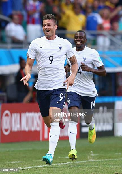 Olivier Giroud of France celebrates scoring his team's first goal during the 2014 FIFA World Cup Brazil Group E match between Switzerland and France...