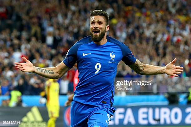 Olivier Giroud of France celebrates scoring his team's first goal during the UEFA Euro 2016 Group A match between France and Romania at Stade de...