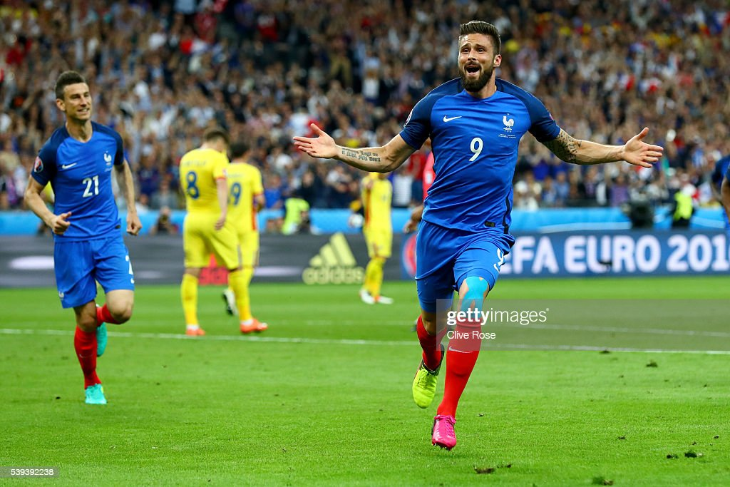 Olivier Giroud of France celebrates scoring his team's first goal during the UEFA Euro 2016 Group A match between France and Romania at Stade de France on June 10, 2016 in Paris, France.
