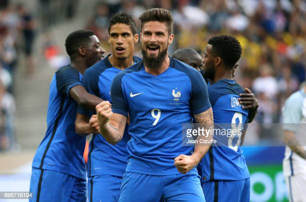 Olivier Giroud of France celebrates the goal of Samuel Umtiti during the international friendly match between France and England at Stade de France...