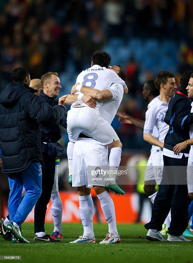 Olivier Giroud (R) of France celebrates with Mathieu Valbuena and other teammates at the end of the FIFA 2014 Group I World Cup Qualifier game between Spain and France at the Vicente Calderon Stadium on October 16, 2012 in Madrid, Spain. Giroud scored his sides last minute equalizing goal.