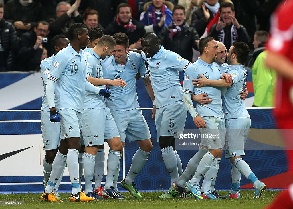 <a gi-track='captionPersonalityLinkClicked' href=/galleries/search?phrase=Olivier+Giroud&family=editorial&specificpeople=5678034 ng-click='$event.stopPropagation()'>Olivier Giroud</a> (5th R) of France celebrates with team-mates <a gi-track='captionPersonalityLinkClicked' href=/galleries/search?phrase=Mamadou+Sakho&family=editorial&specificpeople=4154099 ng-click='$event.stopPropagation()'>Mamadou Sakho</a> #5, <a gi-track='captionPersonalityLinkClicked' href=/galleries/search?phrase=Karim+Benzema&family=editorial&specificpeople=796089 ng-click='$event.stopPropagation()'>Karim Benzema</a>, <a gi-track='captionPersonalityLinkClicked' href=/galleries/search?phrase=Franck+Ribery&family=editorial&specificpeople=490869 ng-click='$event.stopPropagation()'>Franck Ribery</a> and <a gi-track='captionPersonalityLinkClicked' href=/galleries/search?phrase=Christophe+Jallet&family=editorial&specificpeople=2264495 ng-click='$event.stopPropagation()'>Christophe Jallet</a> during the FIFA 2014 World Cup qualifier match between France and Georgia at the Stade de France on March 22, 2013 in Saint-Denis near Paris, France.